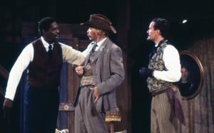 Sir Hugh Evans (Johnny Lee Davenport), Master Page (Michael R. Carleton), and Dr. Caius (Mark Rector) plot revenge against the Host of the Garter. (PHOTO: Orlando-UCF Shakespeare Festival)