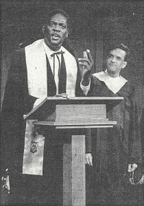 As Purlie Victorious, preaching before a congregation as Charlie (Lance Gharavi) looks on (PHOTO: Courtesy of E. Randahl Hoey)