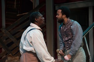 As Simon, demanding to know why John (Keith Mascoll) refrained from telling him that his wife and daughter were sold by Mr. DeLeon (PHOTO: Andrew Brilliant)