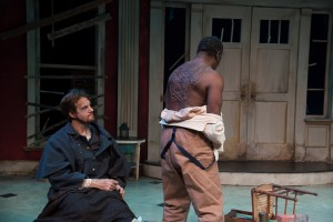 As Simon, revealing to Caleb (Jesse Hinson) that he too was subject to Mr. DeLeon's wrath and the Whipping Man's cruelty (PHOTO: Andrew Brilliant)
