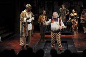 As Poins, a thief (and, in this production, a spy), threatening Sir John Falstaff (Malcolm Ingram) as Peter (Alexander Sovronsky) and look on (PHOTO: Kevin Sprague)